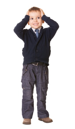 Full-length amazed or surprised child boy holds her head, isolated on white background Stock Photo - 14798436
