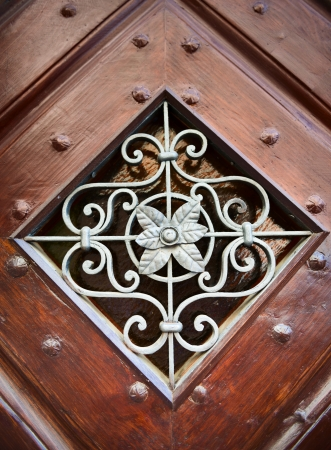 Metal ornamental pattern with leaves in wooden frame Stock Photo - 15117773