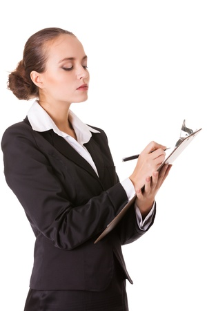 Serious business woman with a clipboard makes notes in document  Isolated on white background