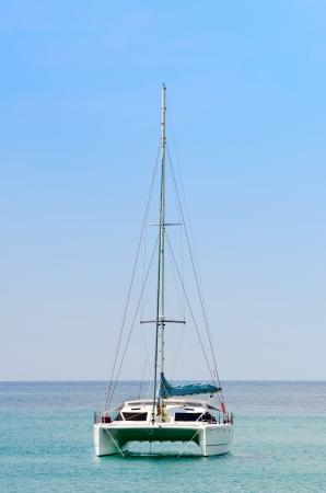Luxury white sail catamaran boat in the sea with blue sky  Archivio Fotografico