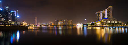 business scene: Panorama of Singapore river and skyline at night