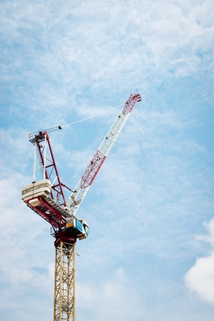 Construction crane against cloudy blue sky in Singapore Stock Photo - 15751908