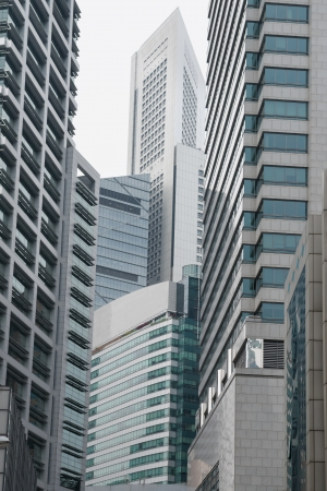 cramped: Cramped modern skyscraper architecture jungle of glass, metal and concrete Stock Photo