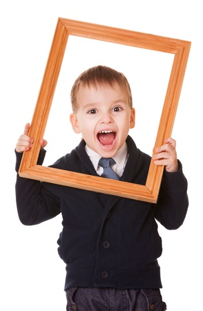 bawl: Shouting caucasian boy, holding a wooden picture frame  Isolated on white background  Stock Photo