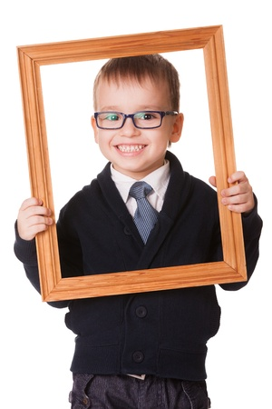 Smiling caucasian boy in glasses, holding a wooden picture frame  Isolated on white background  photo