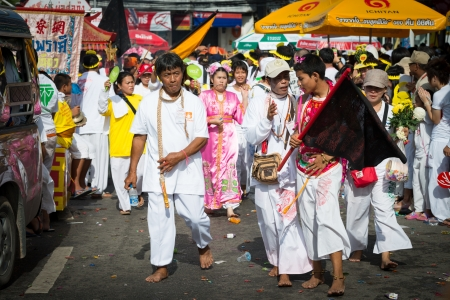 lunar month: Phuket, Thailand - October 21, 2012: An unidentified people on street processions of Phuket Vegetarian Festival. It is an annual event held during the ninth lunar month of the Chinese calendar.  Editorial