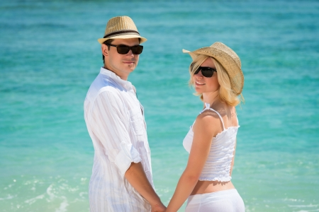 Young couple enjoying their holiday on the beach  photo