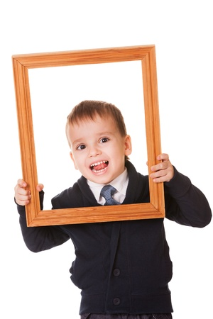 Funny caucasian boy, holding a wooden picture frame  Isolated on white background  photo