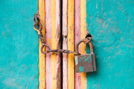 Vintage lock and chain on an old colorful wooden door Stock Photo - 16385809