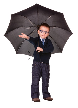 Boy in black clothes under big black umbrella check is it raining or not   Isolated on white Stock Photo - 16984807