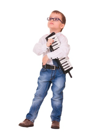 Preschool boy in glasses, jeans and white shirt with melodica, isolated on white background Stock Photo - 16984809