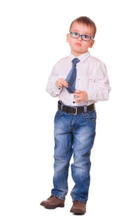 Full-length upset small boy in glasses, jeans and white shirt isolated on white background Stock Photo - 16984806