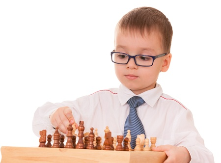 Serious kid playing chess, isolated on white background   Stock Photo