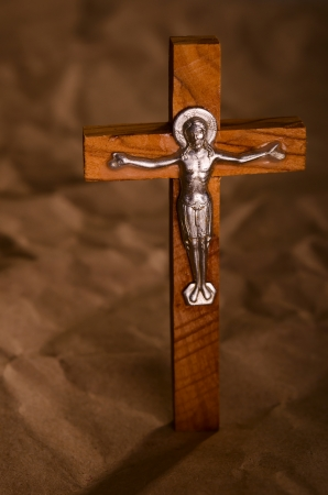 Crucified wooden cross with Jesus Christ vintage background photo