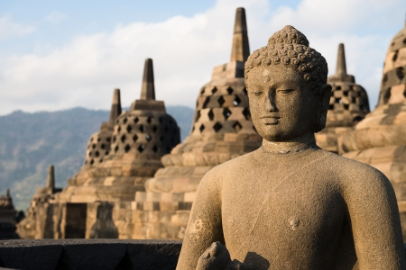 Buddha statue and stupas in Borobudur, or Barabudur, temple Jogjakarta, Java, Indonesia. It is a 9th-century Mahayana temple and the biggest  Buddhist Temple in Indonesia. Stock Photo
