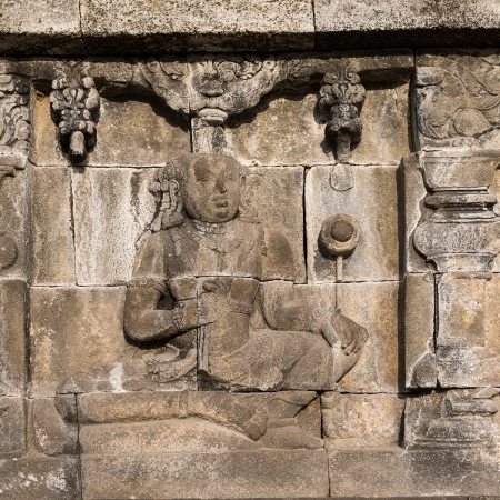 Detail of Buddhist carved relief at Borobudur temple on Java, Indonesia photo