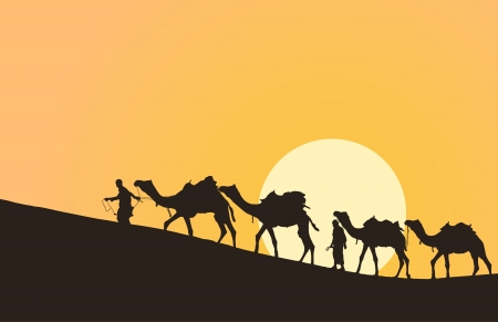 desert sunset: Caravan with camels in desert with sun on background