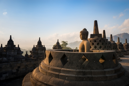 jogjakarta: Buddha statue in open stupa in Borobudur, or Barabudur, temple Jogjakarta, Java, Indonesia at sunrise. It is a 9th-century Mahayana temple and the biggest  Buddhist Temple in Indonesia.