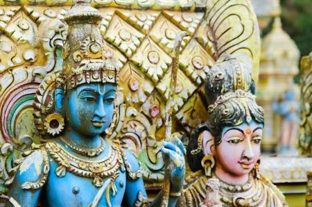 parvati: Shiva with his  wife Parvati on traditional Hindu temple, Nuwara Eliya, Sri lanka