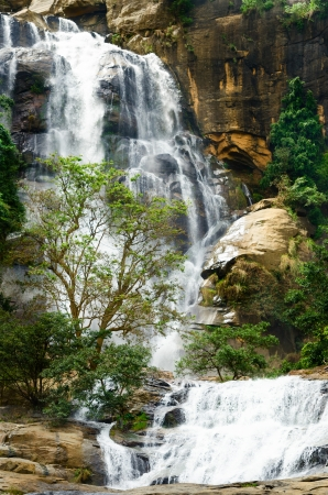 Big waterfall with green trees, Nuwara Eliya, Sri Lanka photo