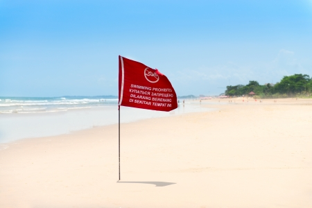 Season of storms  Red flag on the sand beach with no Swimming sign   Stock Photo - 18121261