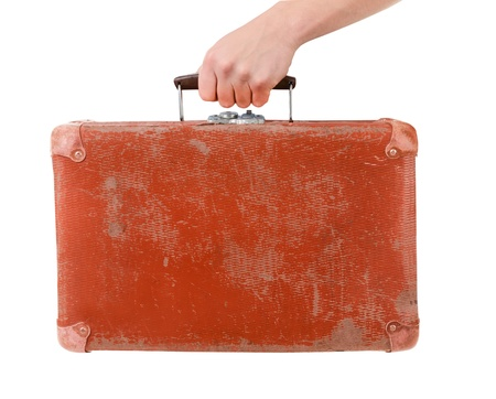 Vintage red suitcase in male hand isolated over white background  photo