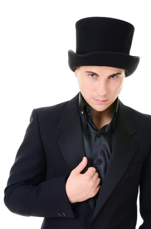 prognostication: Serious strict man illusionist in black suit and high top hat isolated on white background