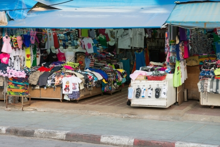 PHUKET, THAILAND - Jan 28: Patong ordinary common street open shop with clothes on Jan 28, 2013 in Phuket, Thailand. Phuket is a famous destination for thousands of tourists. Stock Photo - 18171143