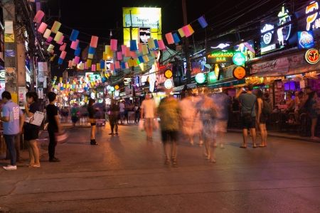 PHUKET, THAILAND - Jan 28: Patong Bangla road with blurred tourists and barkers at night on Jan 28, 2013 in Phuket, Thailand. Bangla road is a famous tourists place with bars and discos.
