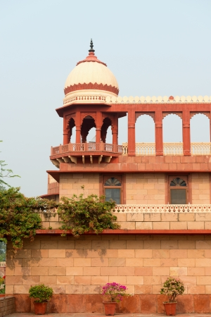 widespread: Building exterior in classical widespread indian style with arches, towers and balcony Editorial