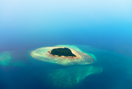Aerial view of the tropical island in blue sea water photo