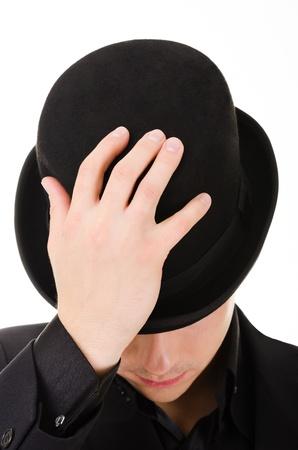 18554981 - Negro sombrero hongo sobre el hombre de moda en estilo retro  aislado sobre fondo blanco 615315c97c6