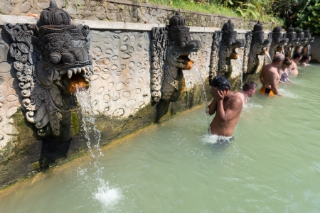 BALI, INDONESIA - SEP 20: People take a bath in termal Banjar Tega hot springs on Sep 20, 2012 in Banjar, Bali, Indonesia. Springs are popular tourist attraction on North Bali.