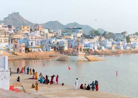 PUSHKAR, INDIA - NOVEMBER 20: Pilgrims take ritual bathing in holy lake on November 20, 2012 in Pushkar, Rajasthan, India. It is one of the five sacred pilgrimage site for devout Hindus. Stock Photo - 18888765