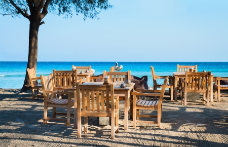 outdoor cafe: Cafe on a tropical beach with blue sea on background