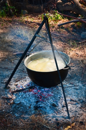 soup kettle: Tourist kettle above a fire with fish soup