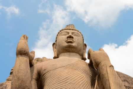 aukana buddha: Avukana standing Buddha statue, Sri Lanka under blue sky. 40 feet (12 m) high, has been carved out of a large granite rock in the 5th century.