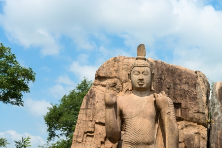 aukana buddha: Avukana standing Buddha statue under blue sky, Sri Lanka  40 feet  12 m  high, has been carved out of a large granite rock in the 5th century