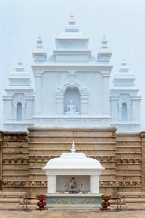 dagoba: Temple with Buddha image statues near white sacred stupa Ruwanmalisaya dagoba, Anuradhapura, Sri Lanka