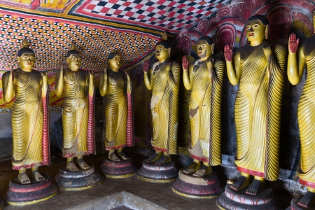 Standing Buddha statues in Dambulla Cave Temple, Sri Lanka photo