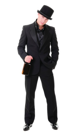 Handsome full-length fashionable man in retro style with bottle of alcohol drink in his hand isolated on white background photo