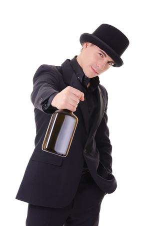 Handsome fashionable man in retro style with bottle of alcohol drink in his hand isolated on white background photo