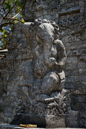 Ganesha elephant statue in front of Pura Luhur Uluwatu Temple, bali photo