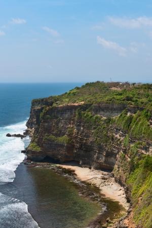 nusa: Cliffs above blue tropical sea on Nusa Dua, Bali, Indonesia Stock Photo