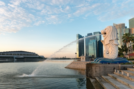 Singapore center with Merlion and skyscrapers at early morning Editorial