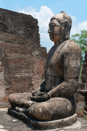buddha sri lanka: Ancient Buddha statue of temple ruins in ancient city of Polonnaruwa, Sri Lanka  Stock Photo