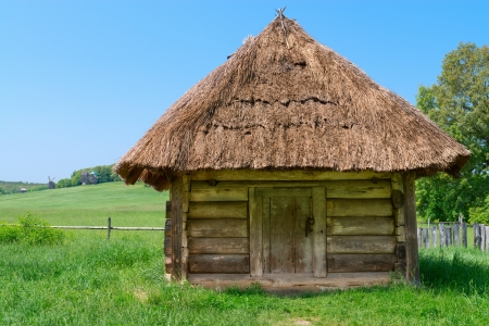 granary: Typical traditional square village antique wooden storehouse or shed with straw roof Stock Photo