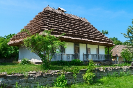 Typical village house in Ukrainian countryside with gardens around