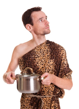 lithic: Looking up wild funny man in animal fell holds cooked food in a stew pan isolated on white background Stock Photo