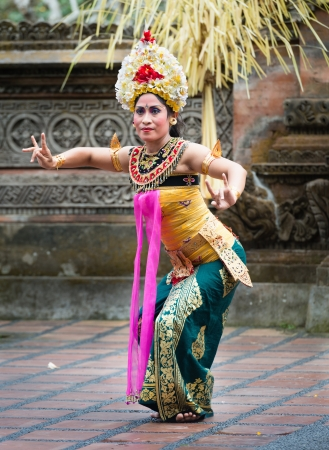 UBUD, BALI, INDONESIA - SEP 21: Unidentified woman performs Legong dance, the traditionala form of Balinese dance on Sep 21, 2012 in Ubud, Bali, Indonesia. Legong is popular tourist attraction on Bali